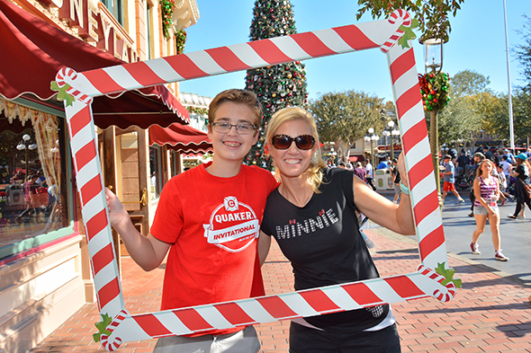 Mother and son enjoying Disneyland Park during the holidays.