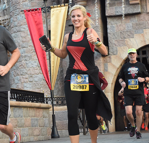 Running through Sleeping Beauty Castle during Super Heroes Half Marathon Weekend.