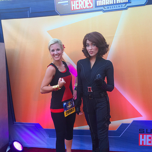 Runner posing with Black Widow during Super Heroes Half Marathon Weekend.