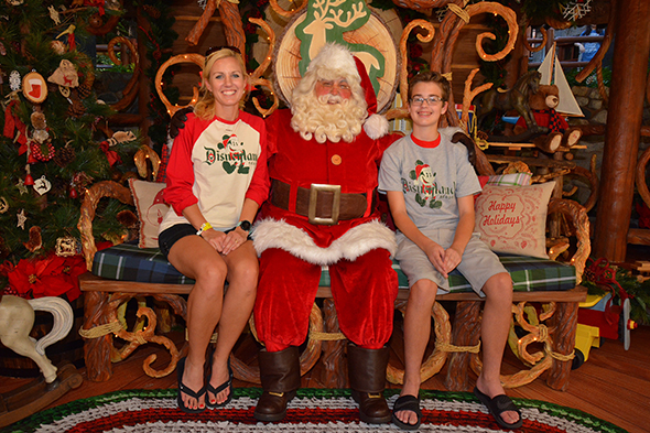 Mother and son with Santa Claus at Disneyland.