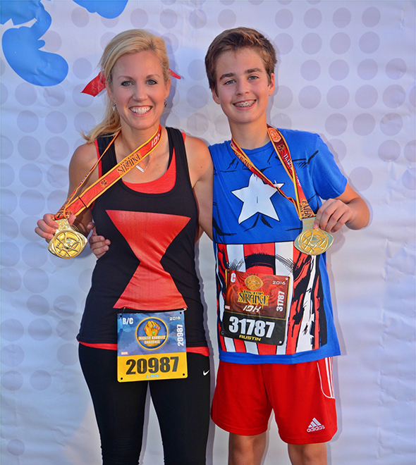 Mother and son celebrating with medals after Doctor Strange 10K at Super Heroes Half Marathon Weekend.